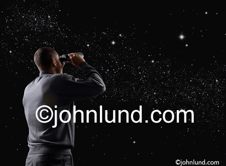 Picture of a man searching the universe, and the night sky, with binoculars in a stock photo metaphor for online searches.