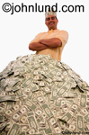 Ethnic man wearing a crown made of money, US dollars, and standing behind a huge pile of money. Again, US Dollars. White background.  His arms are crossed in front of him.
