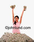 An Hispanic woman stands in a huge pile of money, fists upraised with more dollars and yells out YES to personal wealth. Show me the money. Lovely ethnic woman with long hair and very happy is wearing a pink blouse.