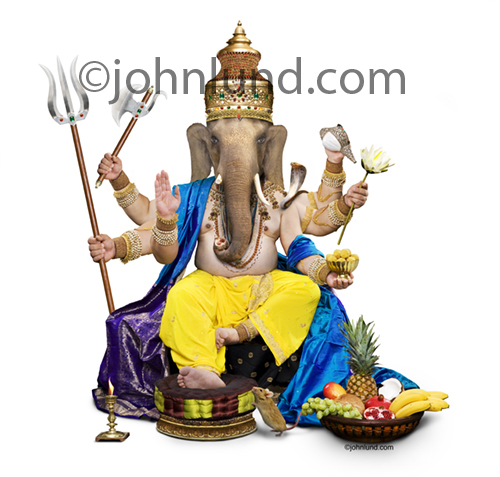 The hindu god Ganesha, also known as Ganapati, the Hindu God and remover of all obstacles, photographed on a white background.
