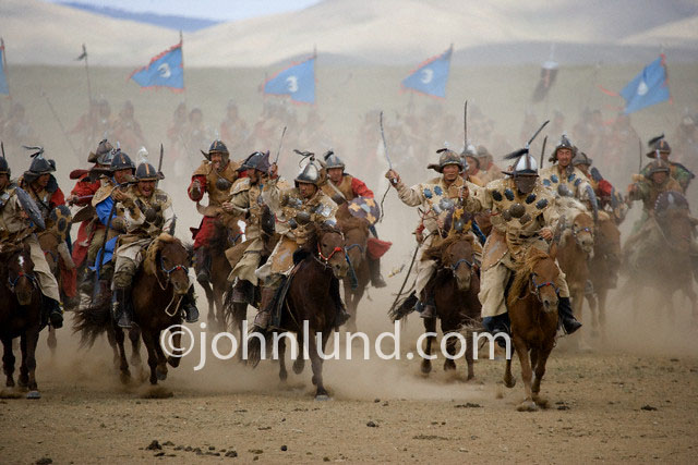 Hordes of Mongol Warriors charge across the Mongolian Steppes in a re-enactment of the life and times of Genghis Khan in celebration of the great emperor's birthday.