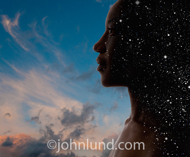 Photo of a woman facing a sunset and melding into a star field symbolizing the journey of looking withn.