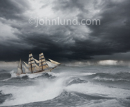 Picture of a tall ship under full sails navigating rough seas in an ocean storm.