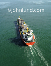 An aerial photo of a tanker ship sailing over the ocean.