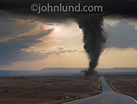 Photo of a tornado threatening a long road stetching into the distance in a concept picture about journeys and challenge.
