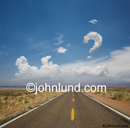 A long road stretches into the distance and below a cloud in the shape of a question mark; What lies ahead, what does the future hold for us?