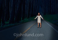 A woman is the deer in the headlights in this humorous picture illustrating the state of being frozen in the face of the unexpected.