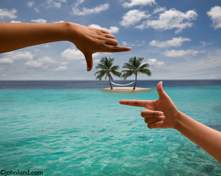 A pair of hands frame a tropical island with a hammock stretched between two palm trees used here to represent visualizing your life