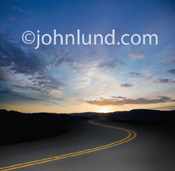 A long winding road heads into a distant sunrise, the road to opportunity and new beginnings.
